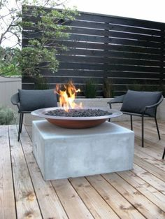 Cosy outdoor space featuring a modern fire pit, to keep things toasty, and an ingenious yet stylish privacy screen