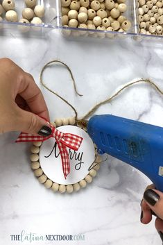 Dollar Tree Farmhouse Christmas Ornaments - The Latina Next Door - - Create these fun Dollar Tree Farmhouse Christmas Ornaments with some simple supplies. Use Christmas phrases or printed pictures for them, it's up to you! Primitive Christmas, Noel Christmas, Christmas Phrases, Primitive Snowmen, Primitive Crafts, Modern Christmas, Dollar Tree Crafts, Christmas Projects, Holiday Crafts