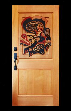 Wolf carved door by Coastal Carvings. Native Drawings, Gros Morne, Native American Decor, Haida Art, Barn Wood Signs, Native Design, Coastal Art, Indigenous Art, Carved Door