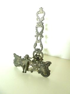 Small Cupid or Angel Frame Holder by loveemmagray on Etsy