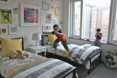 Love the black, white and grey with splashes of brighter colors. Makes it a fun space to play, yet calming at bedtime.