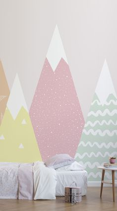 Bring the great outdoors into your child's bedroom or playroom with this magical mountain scene. The Kids Pastel Patterned Mountains Wallpaper Mural features triangular illustrated mountains in different pastel colours and playful pattern details. You and your child will no doubt fall in love with this cool, minimalist wallpaper mural, designed by a team of in-house designers. #wallpaper #murals #wallmurals#interior #design #home #homedecor #decor #accentwall #inspiration