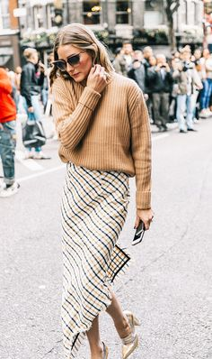 This Exact Kind of Midi Skirt Is the Most Flattering Item You'll Ever Own via @WhoWhatWearUK