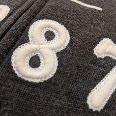 #machineembroidery #retailresearch - Sweatshirt with 3D foam numbers ringed with faux chain- stitch. #stillsick #stayingsaneduringerrands #embroidery makes it better.
