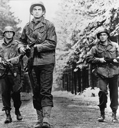 James Mitchum, George Hamilton, and George Peppard in The Victors.