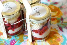 Wedding Dessert Favors In a Jar  --- A friend did this at a wedding we went to this year Emily, and it was super delicious... and cute!  They had like 5 flavors.. and just a small cake for them to cut/save for first anniversary... plus you can customize the jar/lid with fabrics/colors/flowers/etc... Just an idea!