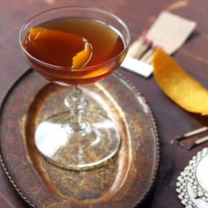 Dubbed the Brow Burner for its garnish of flamed orange peel, this sophisticated take on a classic whiskey and ginger ale highlights the sweet and spicy notes of its ingredients. Drambuie adds a touch of scotch, honey, and herbs, mellowing out the kick of fresh ginger and whole peppercorns.