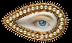 """A """"lover's eye"""" on a brooch surrounded by split pearls, from about 1790, to be shown at the Birmingham Museum of Art."""