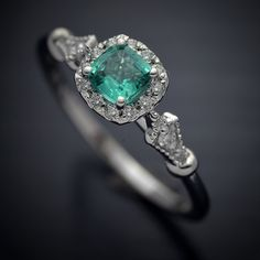 Engagement Ring with Cushion Natural Colombian green Emerald w/ a cushion halo in Micro pave sett in 14kt white gold
