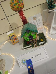 """So we did this """"UP"""" themed gingerbread house for a local group and won first place! Go Figure! What fun! #holiday #party #partyjumpers #fun"""
