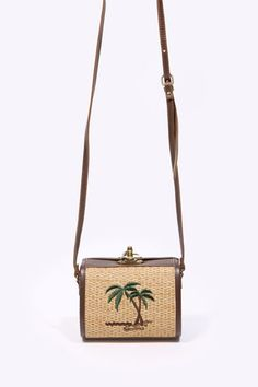 Cute vintage-inspired bag from Urban Outfitters. Love the embroidered palm tree motif!