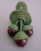 Haskell acorn dress clip with brown glass beads