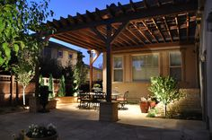 Tuscan Patio and Arbor with Stone Pillars and Lighting Denver