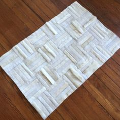 White cowhide patchwork rugs