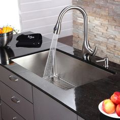 Choosing an undermount stainless-steel kitchen sink by Kraus shows that you are serious about kitchen safety. This single-bowl sink is made from a nonporous material that resists bacteria. The steel surface also makes it easy to clean. Steel Kitchen Sink, Kitchen Taps, Stainless Steel Kitchen, New Kitchen, Kitchen Decor, Kitchen Design, Kitchen Appliances, Kitchen Stuff, Rustic Kitchen