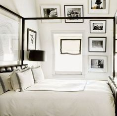 Black and white classy bedroom decor idea with black and white gallery wall.