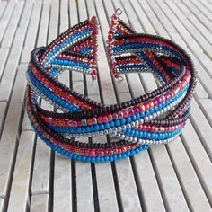 Braided cuff bracelets are easy for you to wear and fun for us to make! This one will go great with denim or brown and is good for someone with
