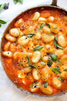 This simple tomato sauce gets tons of flavor from herbs steeped in olive oil that lusciously coats potato pillows of gnocchi.