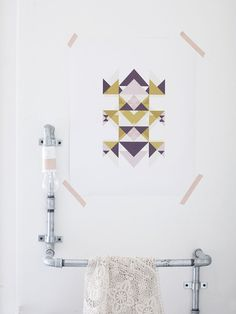 good use of pipes as nightlight and clothes rack plus i love the colored tape on the geometric graphical print!