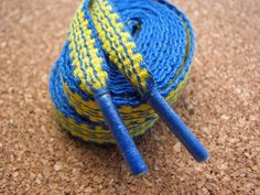 blog.inkledpink.com This is a great tutorial on how to finish a pair of inkle woven shoelaces.