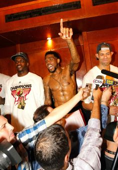 (L-R) Joel Anthony #50, Udonis Haslem #40 and Shane Battier #31 of the Miami Heat celebrate in the locker room after they won 121-106 against the Oklahoma City Thunder in Game Five of the 2012 NBA Finals on June 21, 2012 at American Airlines Arena in Miami, Florida.
