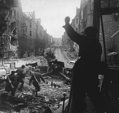 Breslau, Silesia, March 1945: Soviet crew rushes to man a 122mm howitzer firing down Gutenberg Strasse as Sgt Makeev shouts orders from his perch inside a ruined building. The scene is one of utter devastation. The battle for Breslau was bitterly fought by both sides with the deployment of heavy weapons resulting in irreparable damage to the city.