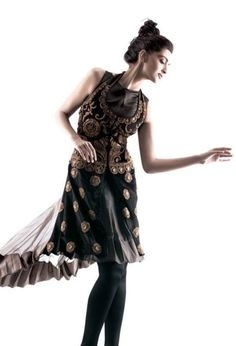 Sonam Kapoor wearing a black and gold dress