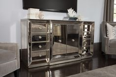 Introduce Hollywood glamour and sparkle into your dining space with the Adiva server bench. The antiqued mirror facades will catch the light and reflect the images of your beautiful dining room decor. Living Room Decor Furniture, City Furniture, Furniture Companies, Living Rooms, Furniture Design, Mirror Tv Stand, Couple Room, Beautiful Dining Rooms, Mirrored Furniture