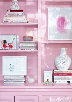 """Parlor: Bookshelves """"I obviously don't take myself very seriously!"""" says homeowner Katie Ukrop about the children's art and framed Fisher-Price toy showcased on the glossy pink shelves. Pink Bookshelves, Pink Shelves, Bookcases, Bookshelf Styling, Unique Bookshelves, Home Office, Color Magenta, Purple, A Study In Pink"""