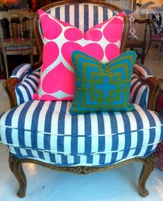 Love this blue stripe chair - looks great with lively pastel pillows for spring/summer, would look fab with plaids for fall/winter.