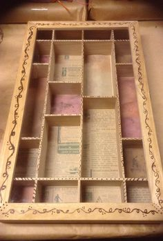 A wood curio box / shadow box with freehand woodburning, then the individual compartments lined with heritage papers.