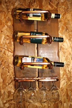 Wine bottle and stemware rack made from reclaimed antique wood and copper pipe.