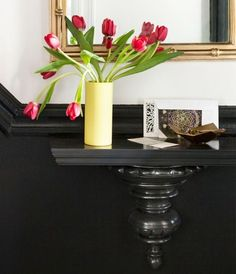 Paint your shelves and walls a dark color to match each other. Instant floating objects!