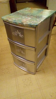 Plastic sterlite drawers with decoupage top, silver paint and stencil on front. definitely looks