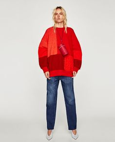Oversized patchwork sweater with a round neckline and long voluminous sleeves.