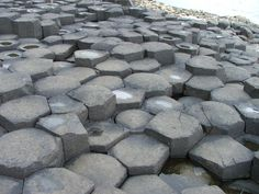 Hexagonal Basalt columns.  Giant's Causeway located in County Antrim in Northern Ireland is a geographical wonder. Made up of about 40,000 interlocking basalt columns. Most of the columns are hexagonal, but there are some ...