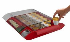 The Mind Reader® Easy Views Coffee Pod Drawer holds 24 K-cup single serve coffee pods. a condiment organizer in the same space.