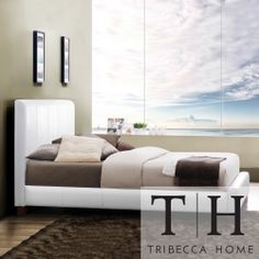 Give your bedroom a stylish update with this white full-size padded bed. Built on a sturdy Asian wood frame, this vinyl-upholstered bed includes headboard, footboard, rails, and slats. Matching baseball stitching gives this bed a sleek finish.