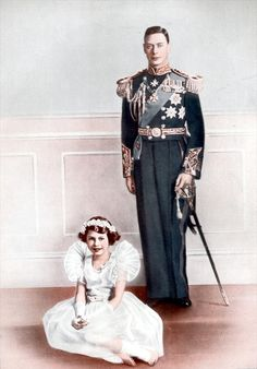 King George VI posing for a portrait with his daughter Princess Elizabeth, later Queen Elizabeth II.