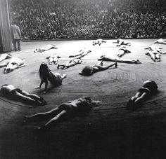 1109-83:  The Living Theatre, 1965  From its conception, The Living Theatre was dedicated to transforming the organization of power within society from a competitive, hierarchical structure to cooperative and communal expression. The troupe attempts to do so by counteracting complacency in the audience through direct spectacle. They oppose the commercial orientation of Broadway productions and have contributed to the off-Broadway theater movement in New York City, staging poetic dramas.  The…