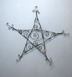 Spiraled Barbed Wire Star Garden Decoration or by thedustyraven