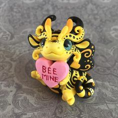 """You make my heart BUZZ"" My sister's came over for craft day last week and one was working on valentine bee kits for her son's class. Of course, because my brain is always dragoning, this little guy was sketched up and made into a sculpture! I love him so much  #valentine #beemine #bee #dragon #sculpture"