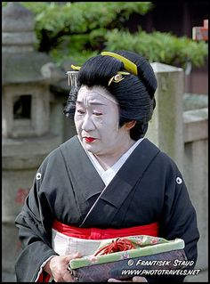 Photograph of Elderly Geisha in Gion district, Kyoto, Japan photos
