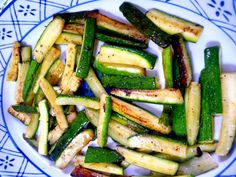 14 oz zucchini (397 g) 1 tbsp olive oil, OR bacon fat (15 mL) 1/2  tsp bottled crushed garlic (2 mL)   (Note: if using fresh, add this right towards the end of cooking) 1/2  tsp salt (2 mL) 1/8  tsp black pepper (0.5 mL) 2 tbsp Parmesan cheese (30 mL)
