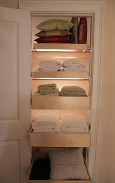 For linen closets, slide-out drawers are a great way to keep contents organized. You can buy drawers on sliders at most home improvement stores – think kitchen drawers that have the same concept. Then just add towels, blankets or whatever you plan to store there to the drawers and instead of having to rummage through them to find what you need, you can simply pull out the drawer for a clear look.