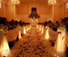 Ceremony Draping down the aisle with 80,000 silk petals