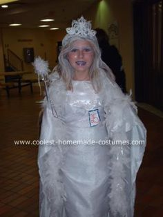 Homemade Snow Queen Costume: This Snow Queen costume is totally handmade without any sewing at all. It started with a dress that was too small, so I wrapped two layers of fabric around