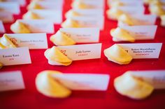 using fortune cookies as placecard holders for my chinese-themed wedding rehearsal dinner