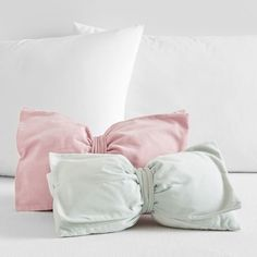 A velvet pillow for your bed that'll let you put a bow on it.   34 Pieces Of Decor You'll Want To Steal From The Kid's Section