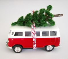 This 1967 VW Bus carries a bottle brush (different than shown) Christmas tree on top and hangs on your Christmas tree by red and white bakers twine. The Bus is the size of a matchbox car, measuring inches long. Available in red, yellow, teal and maroon. Christmas Snow Globes, Christmas Truck, Christmas Images, All Things Christmas, Winter Christmas, Vintage Christmas, Christmas Crafts, Christmas Ornaments, Christmas Ideas